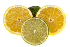 Slices of  yellow lemons and green  limes on white background Stock Photos