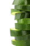 Slices of zucchini. Green and natural slices of zucchini on white background Royalty Free Stock Photo