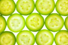 Slices of zucchini or courgette isolated on white Stock Photography