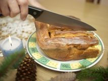 Slicing Baked Pie. Female hands slicing freshly baked pie with knife, shallow depth of field Stock Image