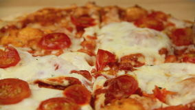 Slicing Baked Pizza stock video