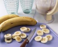 Slicing the bananas Royalty Free Stock Image