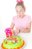 Slicing birthday cake Stock Images