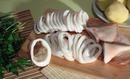 Slicing of boiled calamar Royalty Free Stock Photography