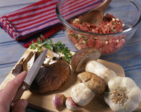 Slicing the boletus mushrooms Stock Photography