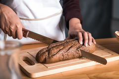 Slicing bread Royalty Free Stock Photography