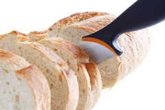 Slicing bread Royalty Free Stock Images