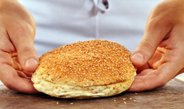 Slicing burger bread Stock Photo