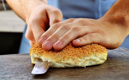 Slicing burger bread Royalty Free Stock Photo