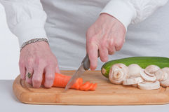 Slicing Carrots. Royalty Free Stock Image