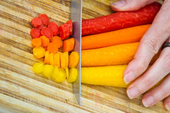 Slicing carrots Stock Photo