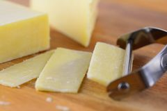 Slicing cheese Royalty Free Stock Photography