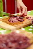 Slicing chicken liver Royalty Free Stock Photography