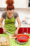 Slicing chicken liver for dinner Stock Photo