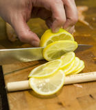 Slicing a citrus fruit Royalty Free Stock Photo
