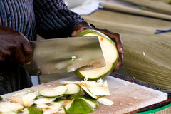 Slicing a coconut Royalty Free Stock Photography