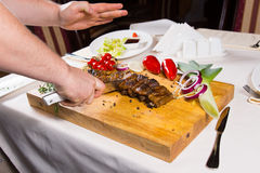 Slicing Cooked Meat on Wooden Chopping Board Stock Photos