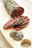 Slicing Corsican dried sausage Stock Photography