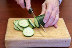 Slicing a cucumber Royalty Free Stock Photos