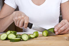 Slicing the cucumbers Royalty Free Stock Photo