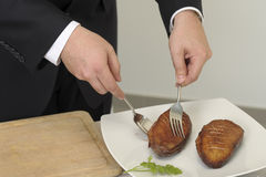 Slicing a duck breast on a carving table Royalty Free Stock Photo