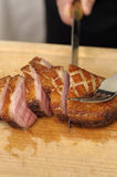 Slicing a duck breast on a carving table Stock Photo