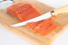 Slicing fish fillet Royalty Free Stock Photography
