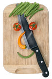 Slicing food with knife smiling vegetables face on cutting board Royalty Free Stock Photography