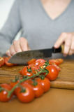 Slicing fresh tomatoes for dinner Royalty Free Stock Photos