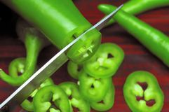 Slicing Green Chillies Royalty Free Stock Photos