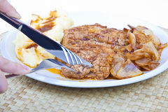 Slicing grilled chicken steak Royalty Free Stock Images