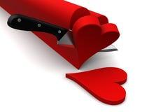 Slicing hearts Stock Image
