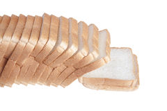 Slicing a loaf of white bread isolated on a white background Royalty Free Stock Photo