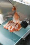 Slicing machine. Prosciutto ham and slicing machine Royalty Free Stock Photos