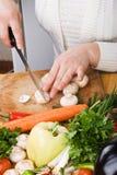 Slicing mushroom royalty free stock photo