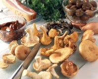 Slicing the mushrooms Royalty Free Stock Image
