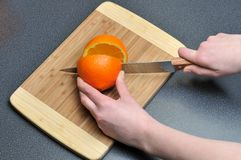 Slicing orange Stock Photo