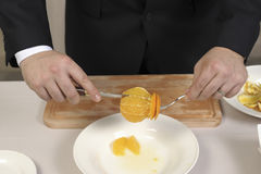 Slicing an orange Royalty Free Stock Images