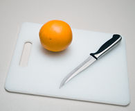 Slicing an Orange Royalty Free Stock Photos