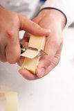 Slicing  of Parmesan Royalty Free Stock Image