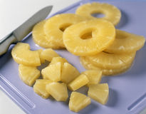 Slicing the pineapple Stock Photos