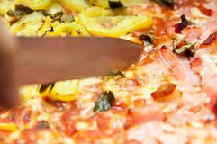 Slicing pizza Stock Photo