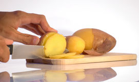 Slicing potatoes Stock Photo