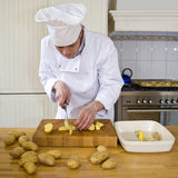 Slicing potatoes Royalty Free Stock Photography