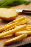 Slicing Potatoes on a Cutting Board. Close up view Royalty Free Stock Photos