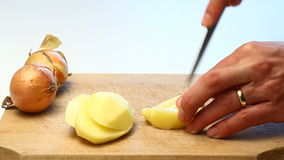 Slicing potatoes video stock video footage