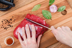 Slicing Raw Meat Royalty Free Stock Photo