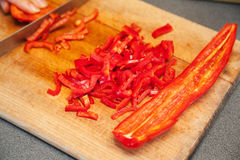 Slicing red sweet pepper Royalty Free Stock Photo