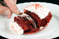 Slicing The Red Velvet Cupcake Royalty Free Stock Photo