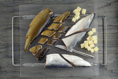 Slicing the sardines and herrings Royalty Free Stock Images